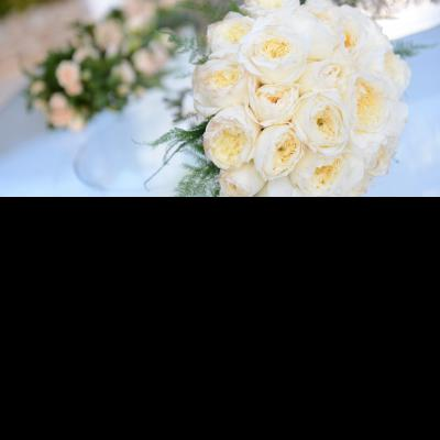 Image of a large wedding flowers bouquet made of white roses